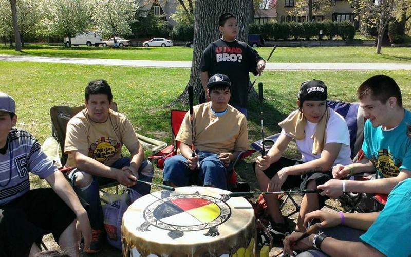 Singing at Mde Maka Ska Canoe Nations Gathering